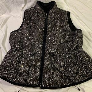 Black and white zip up insulated vest